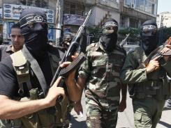 Masked Palestinian militants from the Popular Resistance Committee at a Monday news conference in Gaza City.