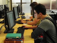 Students use computers at the Howard-Tilton Memorial Library at Tulane University.