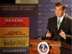 Now outdated: Homeland Security chief Tom Ridge explains the color-coded terror alert system in 2002.