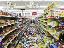 Debris covers the isle at the Miller's mart food store in Mineral, Va., Tuesday.