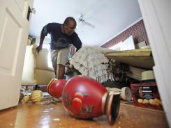 Tony Williams surveys damage at his Mineral, Va., home after an earthquake struck Tuesday.