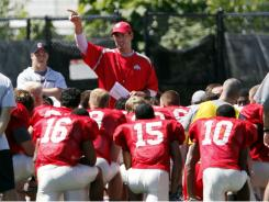 Ohio State head coach Luke Fickell, center, addresses his team after an NCAA college football practice Tuesday, Aug 16, 2011, in Columbus, Ohio.