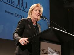 Sen. Kirsten Gillibrand, D-N.Y., speaks at a June event in New York,  encouraging women to get off the sidelines.