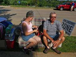 College parents: Sandy and Ralph Winter take a break from unloading while helping move their daughter into the dorms of Clarke University on Wednesday in Dubuque, Iowa.