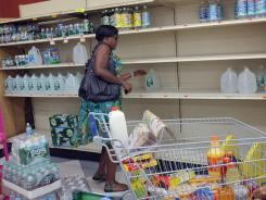 A woman loads up on water while supplies last at a grocery store in the Rockaways area of Queens, N.Y., as Hurricane Irene nears. The Rockaways are under mandatory evacuation orders for tomorrow afternoon.