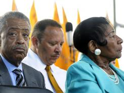 Al Sharpton, left, and Christine King Farris, right, sister of the late Martin Luther King Jr., appear at an impromptu gathering at the Martin Luther King Jr. Memorial in Washington on Friday.