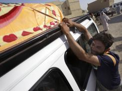 Friends and relatives of Amir Fadhil, 30, grieve during his funeral procession in Baghdad, Iraq, on Monday.