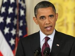 Commander in chief: President Obama discusses Libya in June.