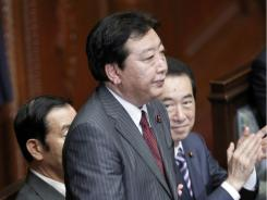 Yoshihiko Noda stands after Japan's lower house elected him as the new prime minister Tuesday.