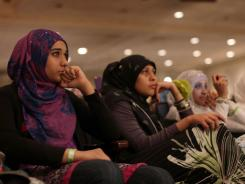 Muslim women participate in the New Horizons gathering June 5 in New York City.  New Horizons looks to bridge the Islamic faith with the struggles and pressures facing American youths.