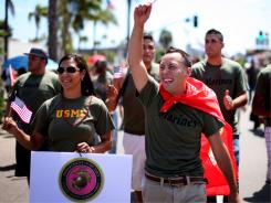 Gay pride parade: Marine Jaime Rincon, right, marches in San Diego in July.