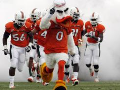 The Miami Hurricanes' mascot leads the team onto the field for an April game at Fort Lauderdale.