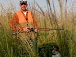 Ryan Giannini hunts with his dog, Gauge, at Highland Hideaway, a captive hunting location.