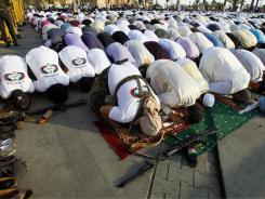 Libyan Muslims pray Wednesday in Green Square, renamed Martyrs Square, during the morning Eid prayer, marking the end of Ramadan.