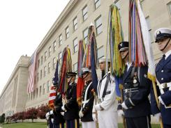 Military honor guard stands at the Pentagon on the 9/11 anniversary in 2007. Asked last month, 42% said the U.S. is winning the war on terror -- the same percentage as 10 years ago.