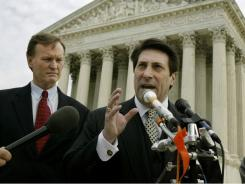 Chief Counsel for the American Center for Law and Justice Jay Sekulow, right, gestures during a news conference outside the Supreme Court on Tuesday, March 2, 2004, in Washington, D.C.