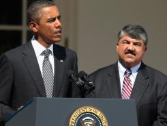 President Obama delivers a statement at the White House on Wednesday as AFL-CIO President Richard Trumka looks on.