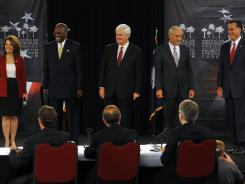 GOP presidential candidates, from left, Minnesota Rep. Michele Bachmann, businessman Herman Cain, former House speaker Newt Gingrich and Texas Rep. Ron Paul  attend the Palmetto Freedom Forum.