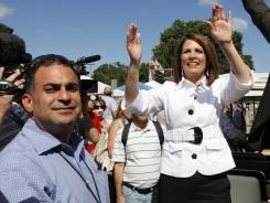 Campaign strategist Keith Nahigian, left, stands next to Republican presidential candidate Rep. Michele Bachmann, R-Minn., at the Republican Party's Straw Poll in Ames, Iowa, on Aug. 13.