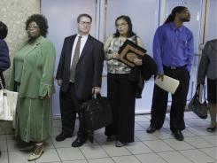Job seekers line up to register at a career fair in Arlington, Va., last month.