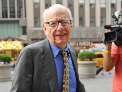 News Corporation head Rupert Murdoch enters the News Corp. building on July 22.