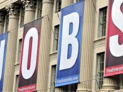 "Giant banners spelling ""JOBS"" hang outside the U.S. Chamber of Commerce building Tuesday in Washington, D.C."