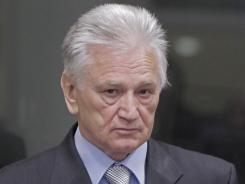 Momcilo Perisic, the former chief of staff of the Yugoslav army, enters the courtroom of the Yugoslav War Crimes Tribunal in The Hague to hear the verdict of the court Tuesday.