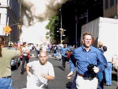 A tower collapses: Pedestrians run from the World Trade Center on Sept. 11, 2001.