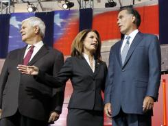 GOP presidential candidates, from left, former House speaker Newt Gingrich, Rep. Michele Bachmann of Minnesota and former Mass. governor Mitt Romney gather Wednesday before a Republican debate at the Reagan Library in Simi Valley, Calif.