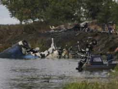 Rescuers work at the crash site of a Russian Yak-42 jet near the city of Yaroslavl on Wednesday.
