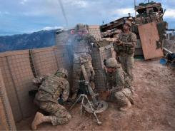 Soldiers fire mortars from Observation Post Mustang in Kunar province.