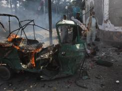 People are seen at the site of bombing in Quetta, Pakistan, on Wednesday.