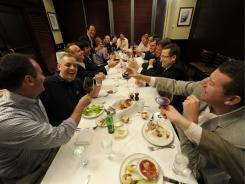 Joseph Bonavita, right, leads his friends in a toast at their First Thursday Foundation dinner in June in New York City.