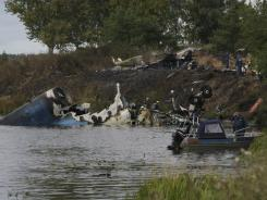 Rescuers work at the crash site of Russian Yak-42 jet near the city of Yaroslavl, on the Volga River about 150 miles northeast of Moscow,  Russia, on Wednesday.