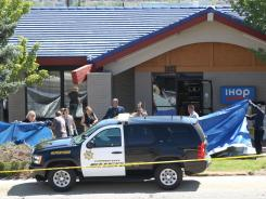 Officials investigate the scene of a shooting in an IHOP restaurant in Carson City, Nev., on Tuesday.