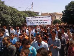 Anti-government protesters march during a demonstration against the Syrian regime on Friday.