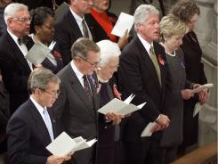 Sept. 14, 2001: President George W. Bush, George H. W. Bush, Barbara Bush, Bill Clinton, Sen. Hillary Rodham Clinton, D-N.Y. and Chelsea Clinton participate in a national day of prayer and remembrance service recalling the 9/11 terrorist attacks at the National Cathedral in Washington, D.C.