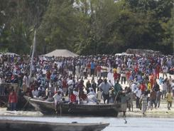 Tanzanians wait near the beach in Zanzibar for the victims of the ship that sank on Saturday.