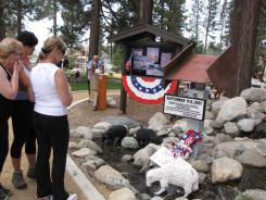 Visitors look at 9/11 memorial at Fawn Park in Fawnskin, Calif. The display includes a steel girder from the NYC twin towers.