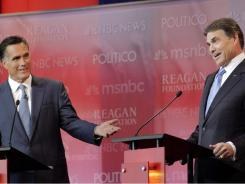 GOP presidential candidates Mitt Romney, left, and Rick Perry go head-to-head during Wednesday's debate in Simi Valley, Calif. Both are racking up congressional nods.