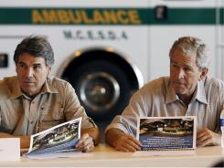 In 2008: President Bush and Texas Gov. Rick Perry visit a command center in San Antonio dealing with Hurricane Gustav.