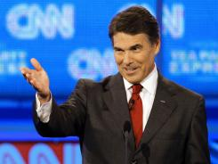 Republican presidential candidate Texas Gov. Rick Perry gestures during a Republican presidential debate Monday in Tampa, Fla.
