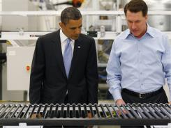 On May 26, 2010, Solyndra executive Chris Gronet shows President Obama a solar panel in Fremont, Calif.