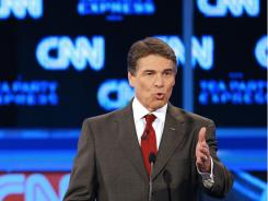 Texas Gov. Rick Perry speaks during a Republican debate Tuesday.
