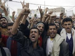 Yemeni protesters chant slogans during a demonstration demanding the resignation of Yemeni president Ali Abdullah Saleh on Wednesday in Sanaa, Yemen.