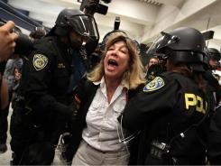Bay Area Rapid Transit (BART) police arrest a  demonstrator in San Francisco on Aug. 22.
