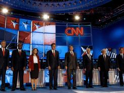 Republican presidential candidates, from left, Jon Huntsman, Herman Cain,  Michele Bachmann,  Mitt Romney, Rick Perry, Ron Paul, Newt Gingrich and  Rick Santorum, before a Republican debate Monday  in Tampa.