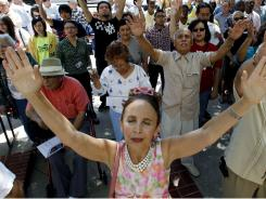 People take part in a National Day of Prayer gathering in San Antonio in May. Polls show that in 1991, 24% of U.S. adults hadn't been to church in the past six months; today, it's 37%.