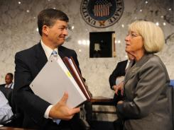 "Rep. Jeb Hensarling and Sen. Patty Murray, co-chairs of the bipartisan deficit reduction  ""supercommittee,"" confer after adjourning a hearing Tuesday."