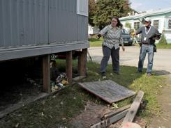 A FEMA inspector, right, talks with a Vermont homeowner to determine whether she qualifies for individual assistance  available to disaster flood victims.